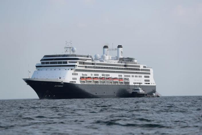 An offshore supply vessel is seen next to the cruise ship MS Rotherdam, which brought supplies and Covid-19 test kits to the MS Zaandam, where four passengers died, pictured off the coast of Panama City