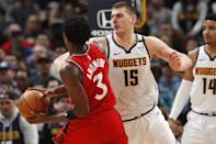 Denver Nuggets center Nikola Jokic, right, defends as Toronto Raptors forward OG Anunoby drives to the rim in the second half of an NBA basketball game Sunday, March 1, 2020. The Nuggets won 133-118. (AP Photo/David Zalubowski)