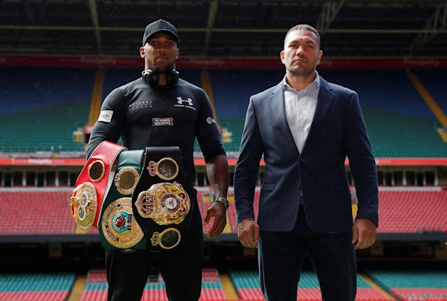 The June 20 heavyweight title bout between Anthony Joshua (L) and Kubrat Pulev was postponed because of the coronavirus, but Pulev's promoters are attempting to have it rescheduled. (Andrew Couldridge/Reuters)