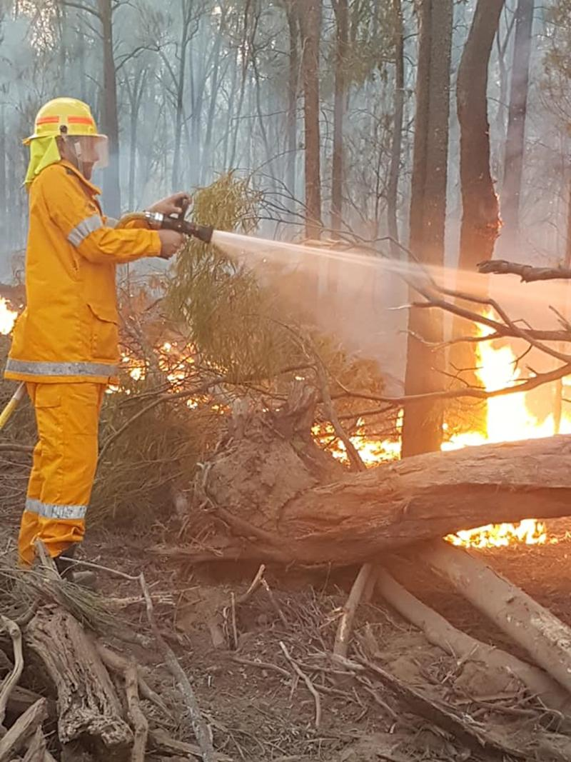 A Queensland firefighter fighting a blaze near Millmerran west of Toowoomba.