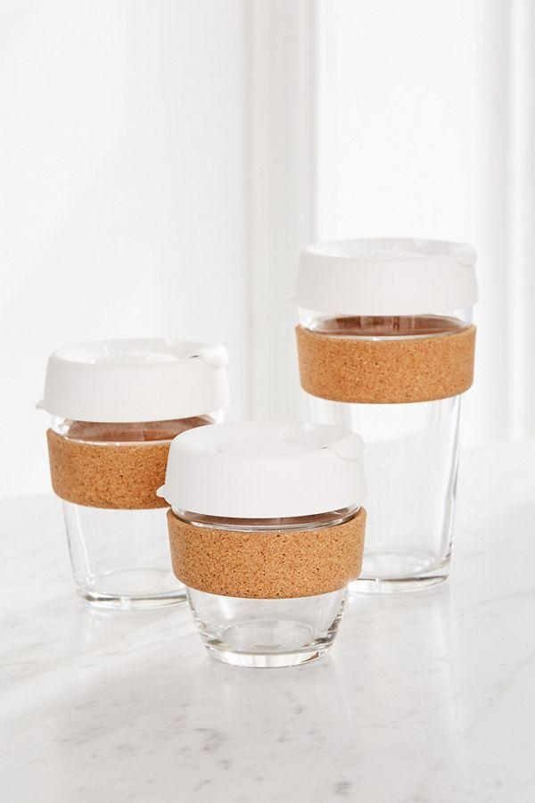 """<p><strong>KeepCup</strong></p><p>urbanoutfitters.com</p><p><strong>$26.00</strong></p><p><a href=""""https://go.redirectingat.com?id=74968X1596630&url=https%3A%2F%2Fwww.urbanoutfitters.com%2Fshop%2Fkeepcup-cork-brew-travel-coffee-mug&sref=http%3A%2F%2Fwww.marieclaire.com%2Fculture%2Fg29685138%2Fsecret-santa-coworkers%2F"""" target=""""_blank"""">SHOP IT</a></p><p>Obviously, coffee is an office essential. But the morning—and afternoon, let's be honest—habit can be wasteful. Give this reusable glass coffee mug to the biggest caffeine-lover on your team. </p>"""