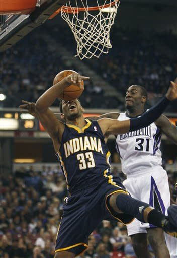 Indiana Pacers forward Danny Granger (33) is fouled under the basket by Sacramento Kings defender J.J. Hickson (31) during the first half of an NBA basketball game in Sacramento, Calif., on Wednesday, Jan. 18, 2012. (AP Photo/Steve Yeater)