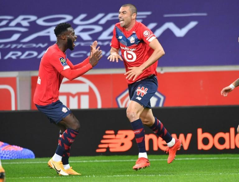 Burak Yilmaz (R) celebrates after scoring for Lille against Lens recently