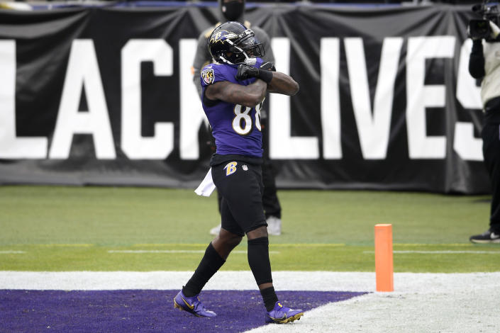 Baltimore Ravens wide receiver Dez Bryant reacts after scoring a touchdown against the Jacksonville Jaguars during the first half of an NFL football game, Sunday, Dec. 20, 2020, in Baltimore. (AP Photo/Nick Wass)