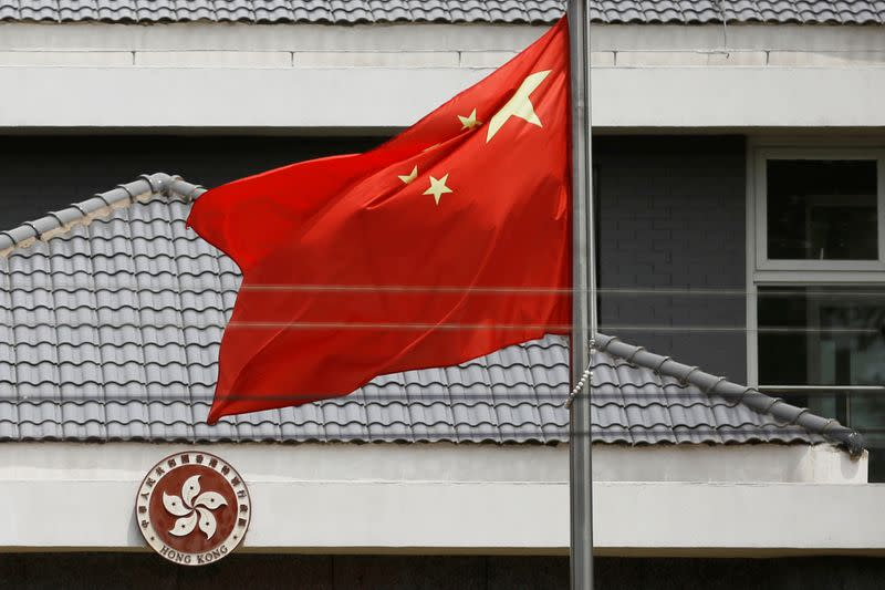 Chinese flag flutters at the office of the Government of the Hong Kong Special Administrative Region in Beijing