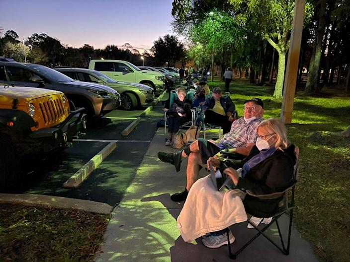 """Marc and Mary Ravis of Cape Coral were the first to line up at the Estero Park and Rec Center off Corkscrew Road on Sunday shortly after it was announced that 300 doses of the Moderna COVID-19 vaccine would be distributed on Monday at 2 p.m. """"I really need this vaccine,"""" Mary Ravis, 69, said. The couple arrived at the site at 7 p.m. Sunday."""