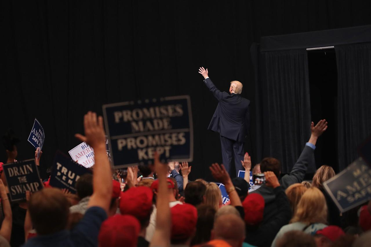 <p>President Donald Trump leaves the stage following a rally on June 21, 2017 in Cedar Rapids, Iowa. Trump spoke about renegotiating NAFTA and building a border wall that would produce solar power during the rally. (Photo: Scott Olson/Getty Images) </p>