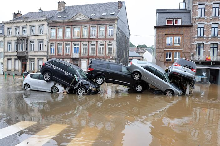 Cars piled up by the floodwaters at a roundabout in the Belgian city of Verviers on Thursday.