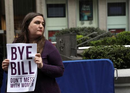 A protestor from the National Organization for Women of New York (NOW-NYC) holds a protest in front of Fox News Channel and the News Corporation Headquarters, following the firing of Bill O'Reilly, in New York