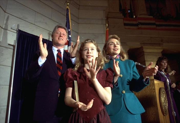 <p>Arkansas Gov. Bill Clinton with his wife, Hillary, and their daughter, Chelsea, in Little Rock in 1991, celebrating his inauguration as governor. (Photo: Danny Johnston/AP)</p>