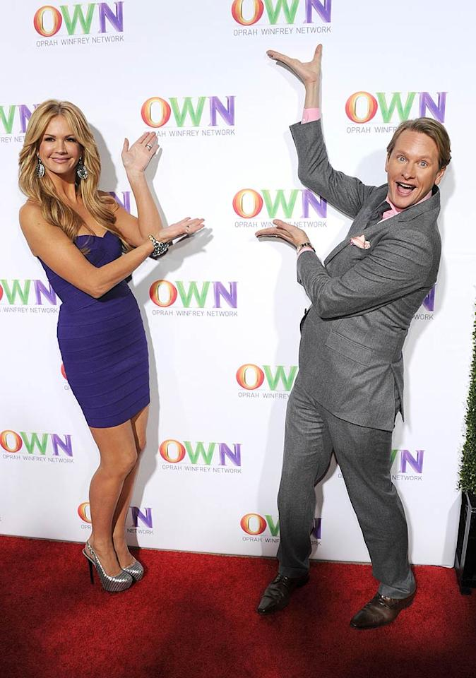 """""""Your OWN Show"""" co-hosts Nancy O'Dell and Carson Kressley hammed it up for the photogs at the party, where guests reportedly noshed on ricotta gnocchi with artichokes and mushrooms, chicken satay with peanut sauce, pineapple crab with vanilla essence, bacon and leek potato globes, and braised rib short beef sliders. Frazer Harrison/<a href=""""http://www.gettyimages.com/"""" target=""""new"""">GettyImages.com</a> - January 6, 2011"""
