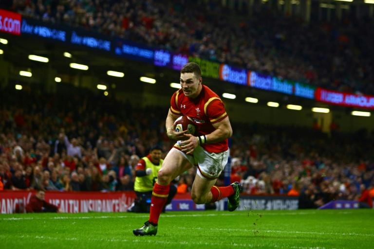 Wales' wing George North runs in his second try during the Six Nations international rugby union match between Wales and Ireland at the Principality Stadium in Cardiff, south Wales, on March 10, 2017