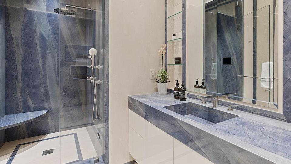 A marble-clad bathroom - Credit: Photo: Anthony Barcelo/Compass