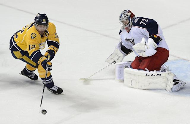 Nashville Predators forward Mike Fisher (12) tries to get a shot off at Columbus Blue Jackets goalie Sergei Bobrovsky (72), of Russia, in the third period of an NHL hockey game on Saturday, March 8, 2014, in Nashville, Tenn. The Blue Jackets won 1-0. (AP Photo/Mark Zaleski)