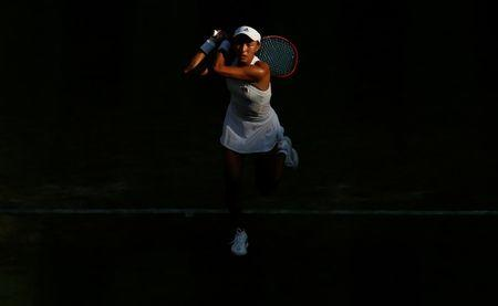 FILE PHOTO: China's Qiang Wang in action during her second round match against USA's Venus Williams at Wimbledon, London  July 5, 2017 REUTERS/Matthew Childs