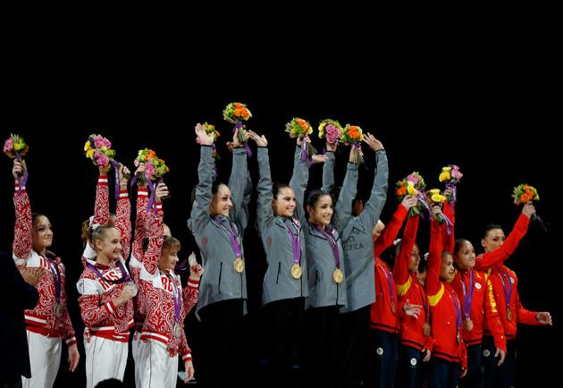LONDON, ENGLAND - JULY 31:  Jordyn Wieber, Gabrielle Douglas, Mc Kayla Maroney, Alexandra Raisman and Kyla Ross of the United States celebrate on the podium after winning the gold medal in the Artistic Gymnastics Women's Team final on Day 4 of the London 2012 Olympic Games at North Greenwich Arena on July 31, 2012 in London, England.  (Photo by Jamie Squire/Getty Images)