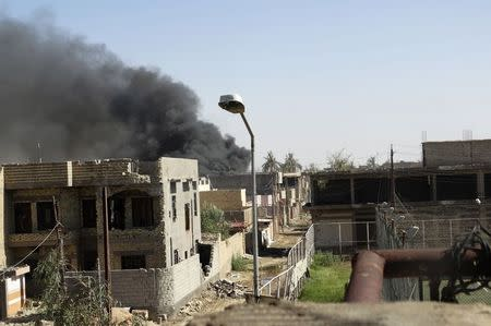 Smoke rises during clashes between Iraqi security forces and militants of the Islamic State, formerly known as the Islamic State in Iraq and the Levant (ISIL) in Ramadi