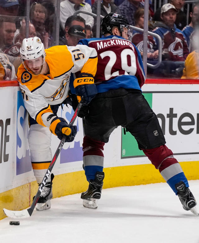 FILE - In this April 22, 2018, file photo, Nashville Predators' Austin Watson (51) slips past Colorado Avalanche center Nathan MacKinnon (29) during the second period in Game 6 of an NHL hockey first-round playoff series in Denver. Watson says the arrest last year that led to his 18-game suspension came when he started drinking again after 23 months of sobriety. (AP Photo/Jack Dempsey, File)