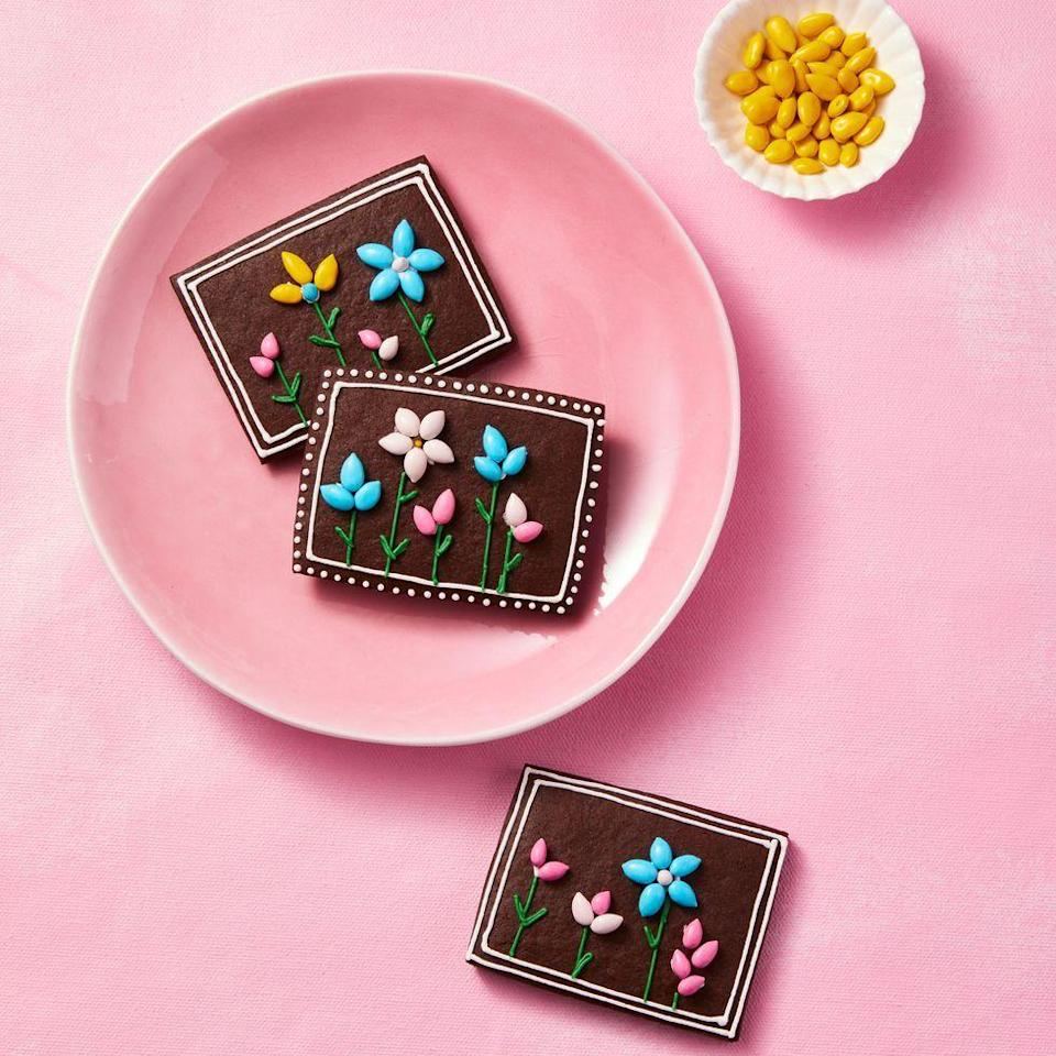 """<p>Classic sugar cookies get a chocolate twist. We used tinted icing and candied sunflower seeds to create the sweet flowers you see. </p><p><a href=""""https://www.goodhousekeeping.com/food-recipes/a35396698/chocolate-sugar-cookies-recipe/"""" rel=""""nofollow noopener"""" target=""""_blank"""" data-ylk=""""slk:Get the recipe for Chocolate Sugar Cookies »"""" class=""""link rapid-noclick-resp""""><em>Get the recipe for Chocolate Sugar Cookies »</em></a></p>"""
