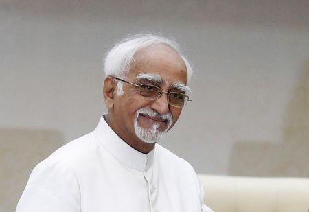 India's Vice President Ansari smiles before a meeting with Cambodia's Prime Minister Hun Sen at the Prime Minister's office in Phnom Penh