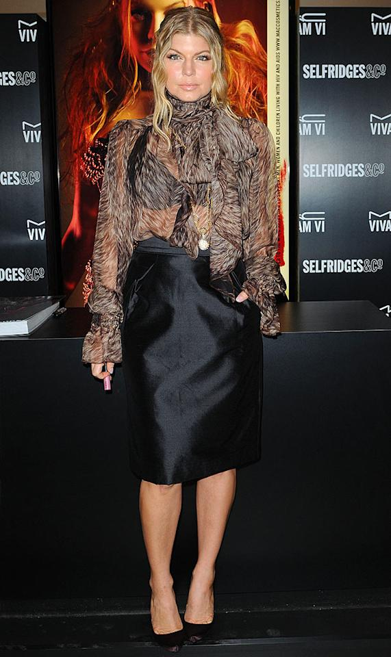 "Fergie's see-thru D&G blouse and boxy black skirt do nothing for her fergalicious frame. <a href=""http://www.splashnewsonline.com"" target=""new"">Splash News</a> - December 11, 2008"