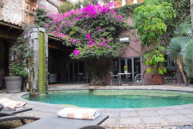 <p>Historic architecture and modern swimming pool at El Meson hotel in San Miguel de Allende, Mexico. </p>
