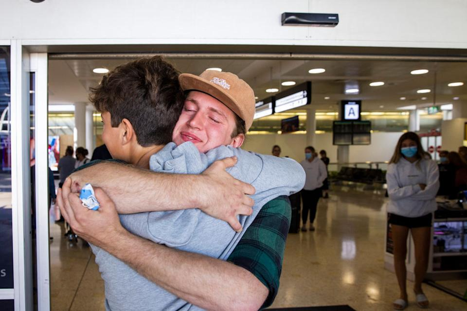 Levi Teen is embraced after arriving from New Zealand at Sydney International Airport in Sydney, Australia.