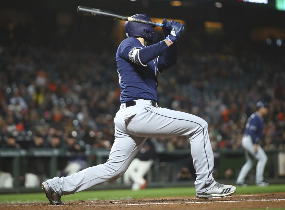 San Diego Padres' Eric Hosmer follows through on a two-run single off San Francisco Giants' Chris Stratton during the third inning of a baseball game Tuesday, Sept. 25, 2018, in San Francisco. (AP Photo/Ben Margot)