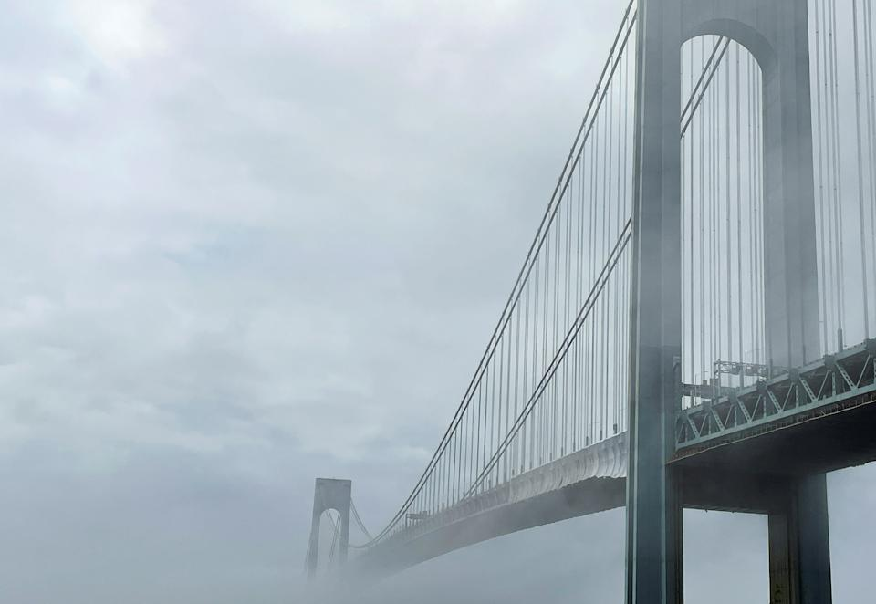 The Verrazzano-Narrows bridge connecting the Brooklyn and Staten Island boroughs is pictured in morning fog in New York City, New York, U.S., June 26, 2021. Picture taken June 26, 2021. REUTERS/Nick Zieminski