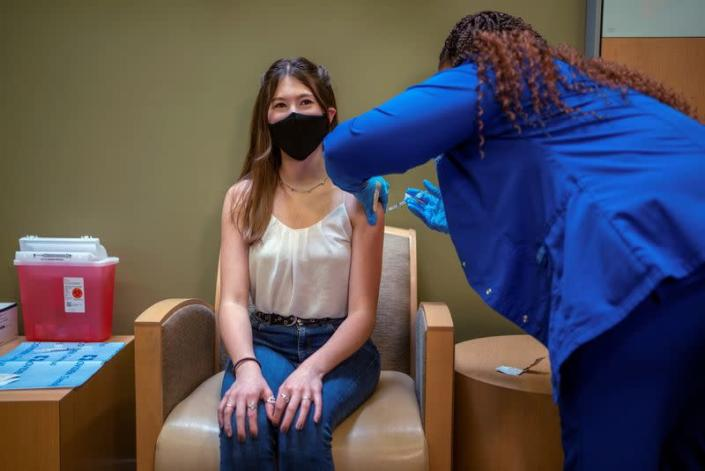 FILE PHOTO: FILE PHOTO: CDC approves Pfizer vaccine for teenagers