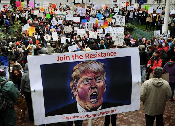 <p>Protesters carry anti-Trump signs during a 'Not My President's Day' demonstration outside City Hall in Los Angeles, on Feb. 20, 2017. (Mark Ralston/AFP/Getty Images) </p>