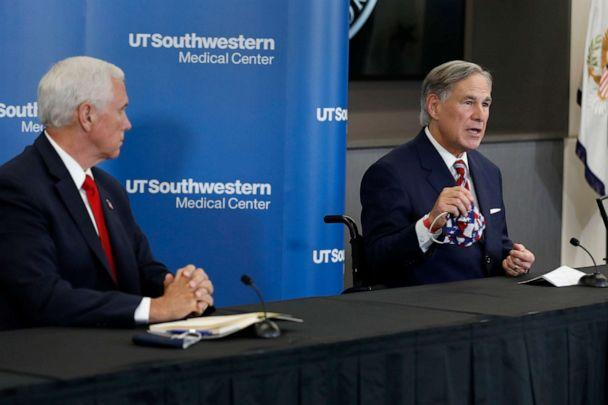 PHOTO: Vice President Mike Pence listens as Texas Gov. Greg Abbott, right, holds up a mask and discusses the importance of wearing one, during a news conference in Dallas, June 28, 2020. (Tony Gutierrez/AP)