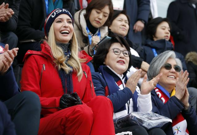Snowboarding - Pyeongchang 2018 Winter Olympics - Men's Big Air Finals - Alpensia Ski Jumping Centre - Pyeongchang, South Korea - February 24, 2018 - U.S. President Donald Trump's daughter and senior White House adviser, Ivanka Trump reacts as Kim Jung-sook, wife of South Korea's President Moon Jae-in, cheers in the stands. REUTERS/Eric Gaillard