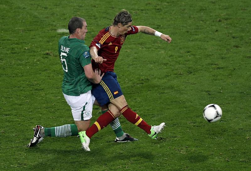 Ireland's Richard Dunne tackles Spain's Fernando Torres as Torres scores his side's third goal during the Euro 2012 soccer championship Group C match between Spain and Ireland in Gdansk, Poland, Thursday, June 14, 2012. (AP Photo/Gero Breloer)
