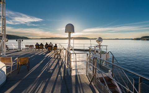 Passengers relax on deck as Spitsbergen sails into Newfoundland - Credit: Karsten Bidstrup