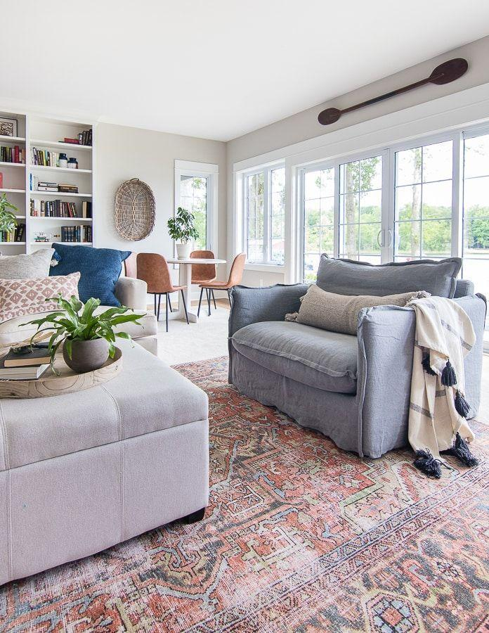"""<p>When the sun has set at your lake house, retreat to this comfy, informal basement family room. You'll love curling up with a good book in a comfy, oversized chair, or playing games at the round table in the corner nook. </p><p><strong>See more at <a href=""""https://www.thelilypadcottage.com/?s=basement"""" rel=""""nofollow noopener"""" target=""""_blank"""" data-ylk=""""slk:Lily Pad Cottage"""" class=""""link rapid-noclick-resp"""">Lily Pad Cottage</a>. </strong></p><p><a class=""""link rapid-noclick-resp"""" href=""""https://go.redirectingat.com?id=74968X1596630&url=https%3A%2F%2Fwww.walmart.com%2Fip%2FDecMode-Coastal-41-x-6-inch-wooden-decorative-oar%2F46781593&sref=https%3A%2F%2Fwww.redbookmag.com%2Fhome%2Fg36061437%2Fbasement-ideas%2F"""" rel=""""nofollow noopener"""" target=""""_blank"""" data-ylk=""""slk:SHOP DECORATIVE OARS"""">SHOP DECORATIVE OARS</a></p>"""
