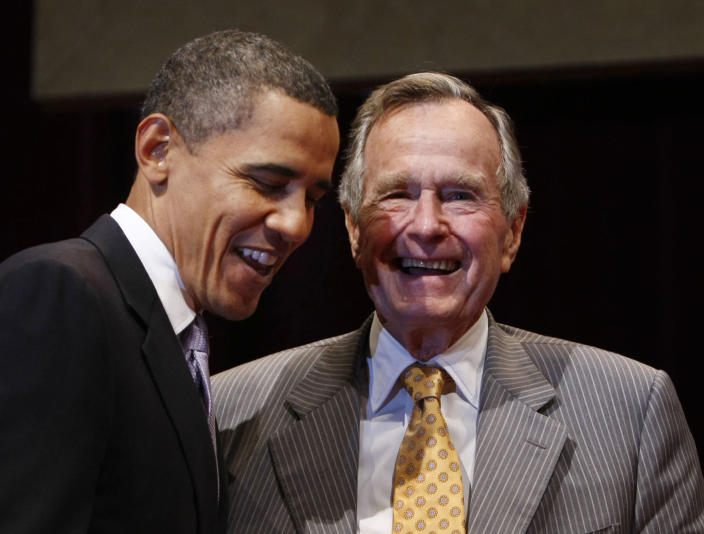 <p>President Barack Obama and former President George H.W. Bush talk after the Points of Light Institute forum at Texas A&M University in College Station, Texas, on Oct. 16, 2009. (Photo: Gerald Herbert/AP) </p>