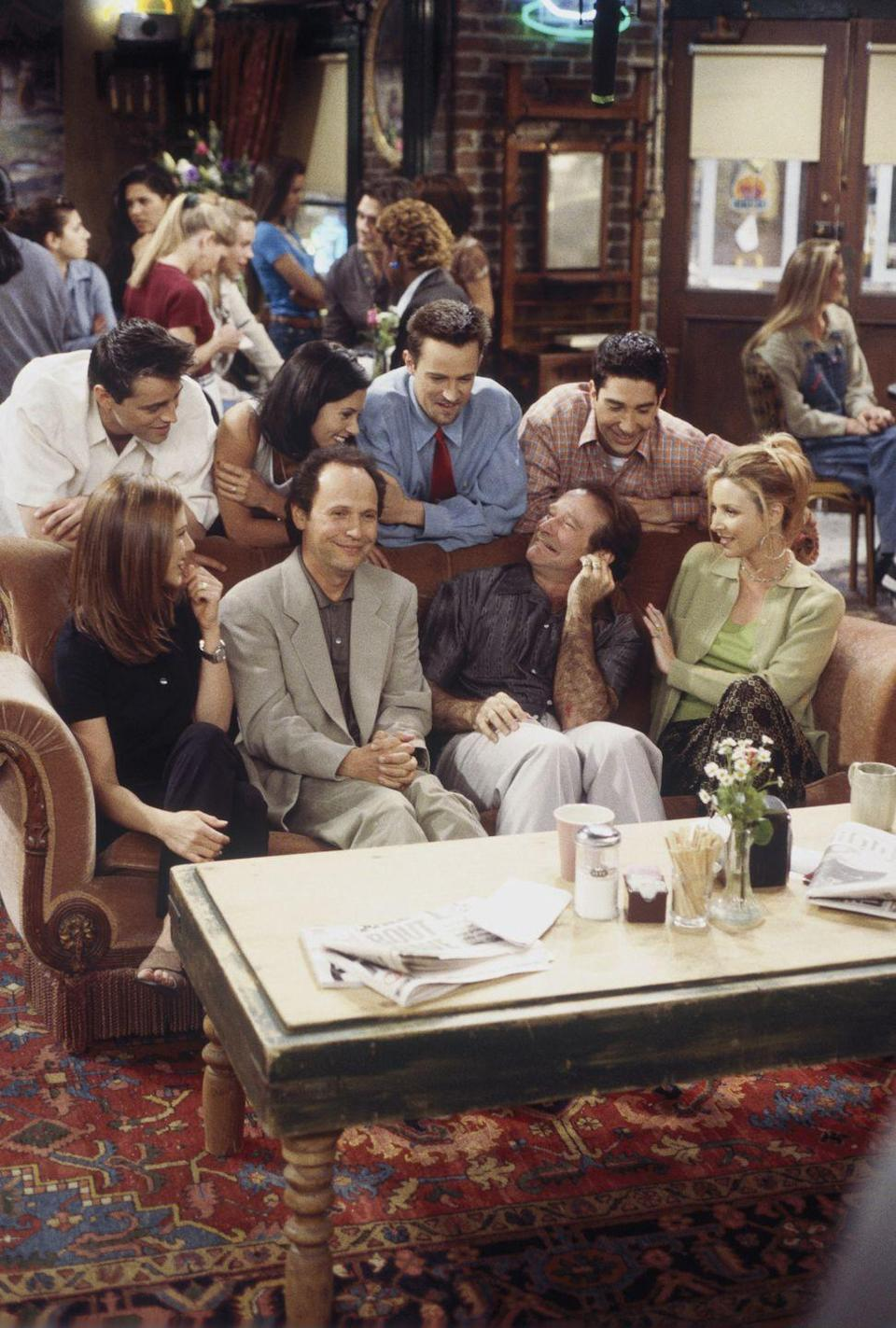 """<p>It was by chance that Billy Crystal and Robin Williams happened to be on the same lot as <em>Friends</em> when the cast was filming """"The One with the Ultimate Fighting Champion"""" in season 3. The comedians decided to stop by for a cup of coffee, during which an improvised conversation unfolds, leaving both the cast and audience in stitches.</p>"""