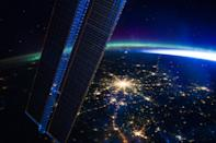 The bright lights of Russia's capital city Moscow are seen beneath the colourful rays of the aurora borealis. The image was recently captured by astronauts on board the International Space Station flying at an altitude of approximately 240 miles.