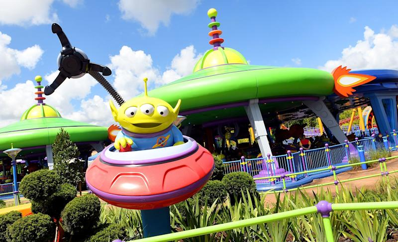 "During the ride, the green aliens (pictured here) try to get captured by ""the claw."""