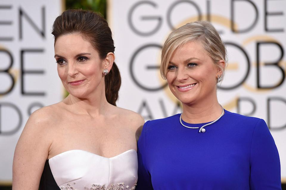 Tina Fey and Amy Poehler will host the 78th Golden Globes from two coasts for the first time, with Fey live in New York and Poehler in Beverly Hills, Calif.