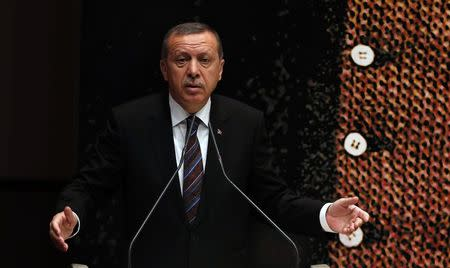 Turkey's Prime Minister Tayyip Erdogan addresses the audience at a meeting at his ruling Ak Party headquarters in Ankara