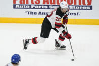 New Jersey Devils' Michael McLeod (20) looks to pass the puck during the second period of the team's NHL hockey game against the New York Islanders on Thursday, May 6, 2021, in Uniondale, N.Y. (AP Photo/Frank Franklin II)