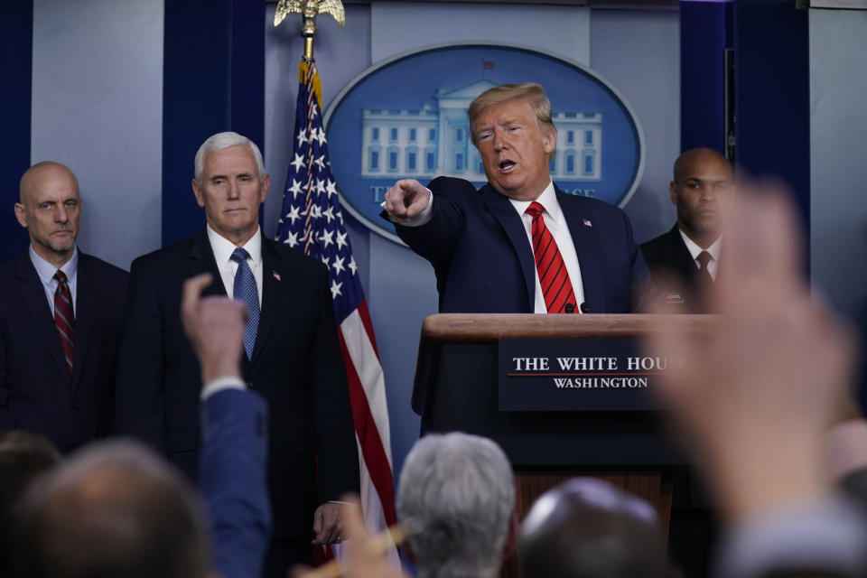 President Donald Trump takes questions during press briefing with the coronavirus task force, at the White House, Thursday, March 19, 2020, in Washington. From left, Food and Drug Administration Commissioner Dr. Stephen Hahn, Vice President Mike Pence, Trump and Surgeon General Jerome Adams. (AP Photo/Evan Vucci)