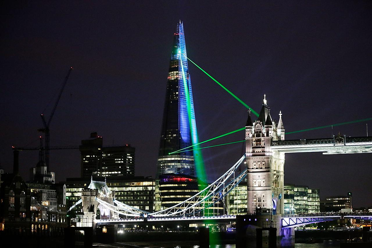 Laser lights shine from The Shard over Tower Bridge on July 5, 2012 in London, England. The European Union's highest building designed by Italian architect Renzo Piano, stands at 310 meters tall situated on London's Southbank is formally inaugurated this evening at 10pm with a laser show that will also be streamed live on the internet.  (Photo by Matthew Lloyd/Getty Images)