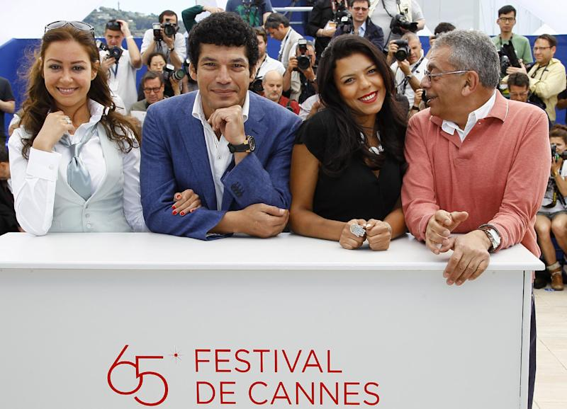 From left, actors Menna Shalaby, Bassem Samra, Nahed El Sebai, and director Yousry Nasrallah pose during a photo call for After the Battle at the 65th international film festival, in Cannes, southern France, Thursday, May 17, 2012. (AP Photo/Francois Mori)