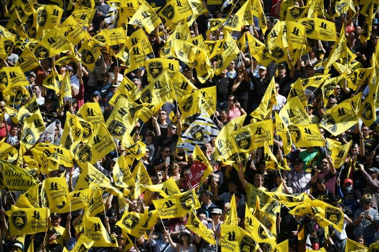 La Rochelle's supporters wave their club's flags during the French Top 14 rugby union match between La Rochelle and Bordeaux-Begles on April 08, 2017