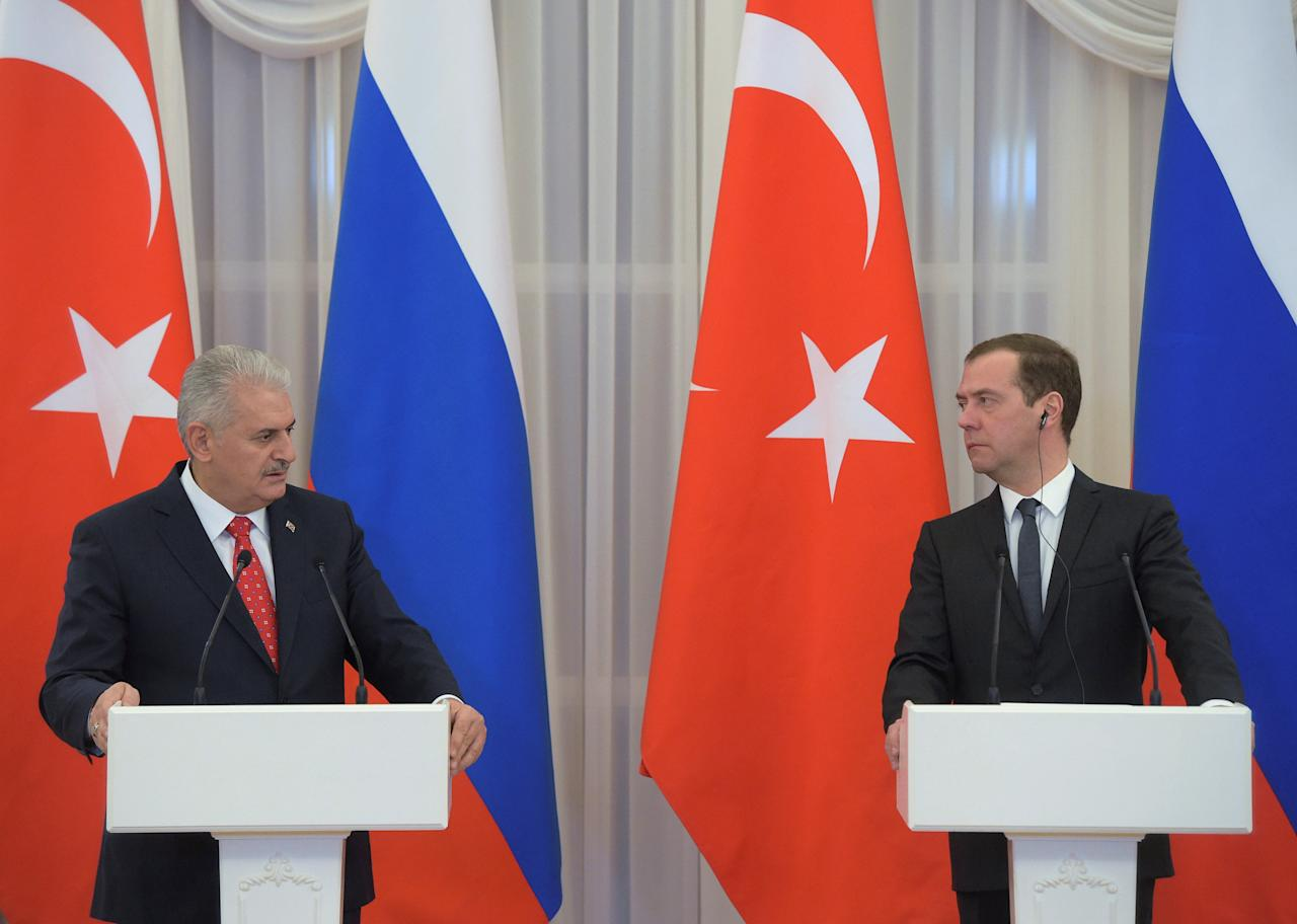 Russian Prime Minister Dmitry Medvedev and Turkish Prime Minister Binali Yildirim attend a joint news conference at the Gorki state residence outside Moscow, Russia, December 6, 2016. Sputnik/Pool/Alexander Astafyev via REUTERS ATTENTION EDITORS - THIS IMAGE WAS PROVIDED BY A THIRD PARTY. EDITORIAL USE ONLY.