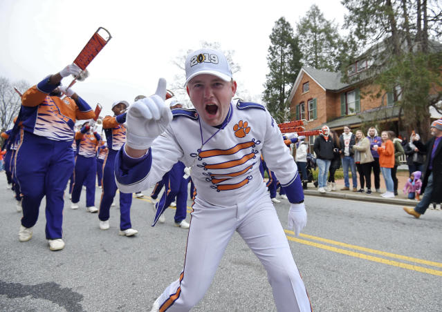 A Clemson band member shows his excitement during a parade honoring Clemson Saturday, Jan. 12, 2019, in Clemson, S.C., The Tigers defeated Alabama 44-16 in the College Football Playoff championship game Monday Jan. 7. (AP Photo/Richard Shiro)