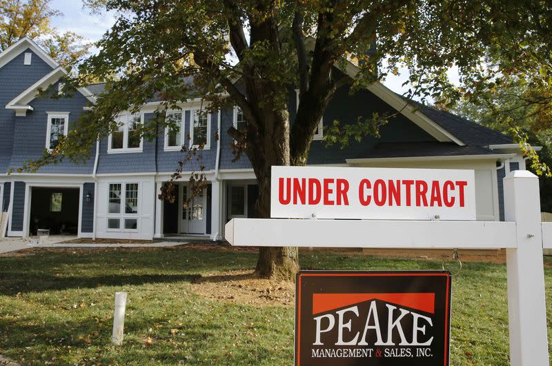 "A real estate sign advertising a home ""Under Contract"" is pictured in Vienna, Virginia"